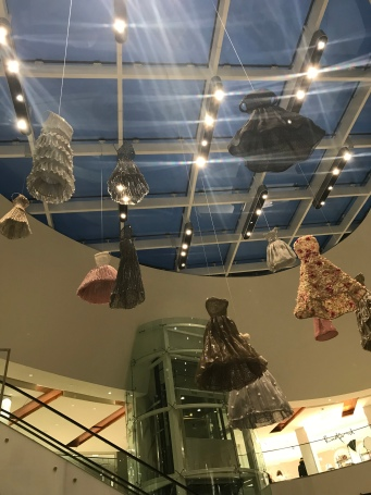 dresses hanging from the ceiling