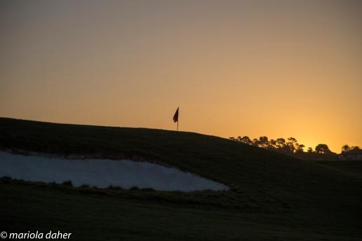 hole 1 at sunrise at Spanish Bay Golf course