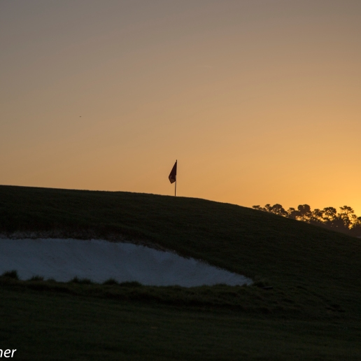 hole 1 at sunrise at Spanish Bay Golf course